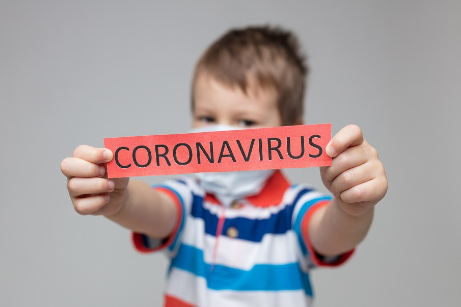 Young child wearing a respiratory mask as a prevention against the deadly Coronavirus Covid-19